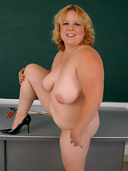 Blonde Mature Plump Blonde plump mature teacher shows pussy on the table