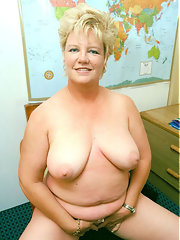 Glassed plump blonde mature toying pussy on the armchair blonde mature plump